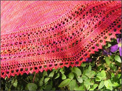 Lochmusterrand eines roten Tuchs