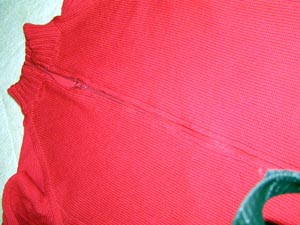 rote strickjacke mit Reissverschluss