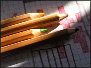Buntstifte und Karopapier