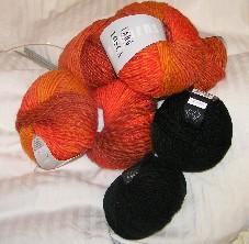 schwarze und orange Wollknäuel
